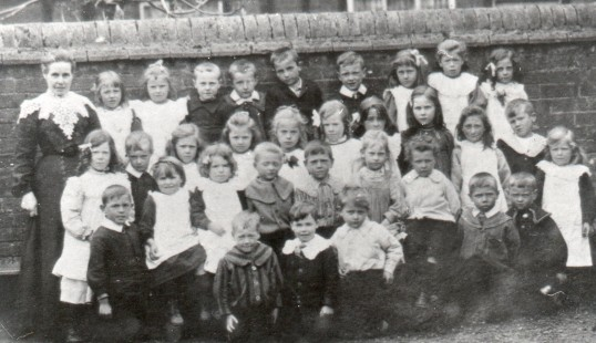 Mrs Alma Marchant with children from Wilburton Primary School, c.1904.