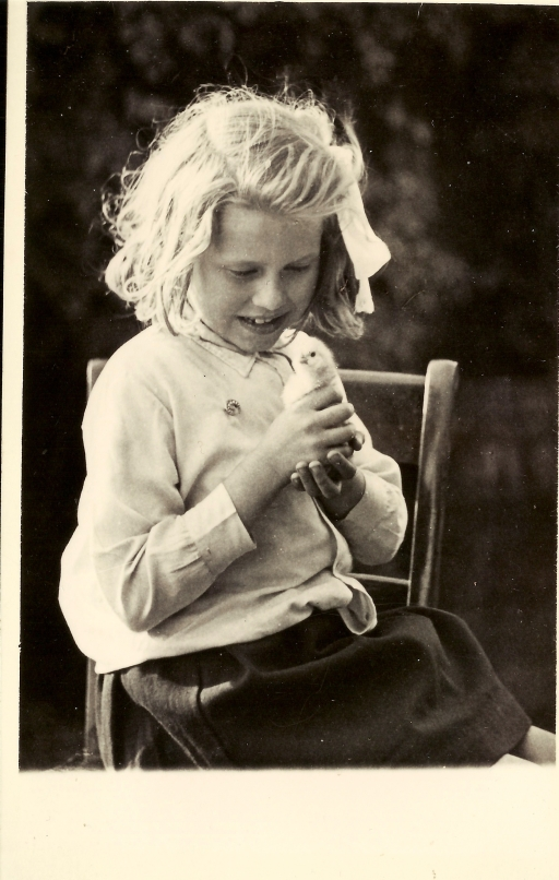Pamela Maud Barber cradling a duckling c.1938