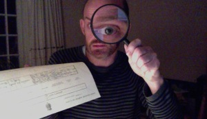 Man holding magnifying glass and death certificate
