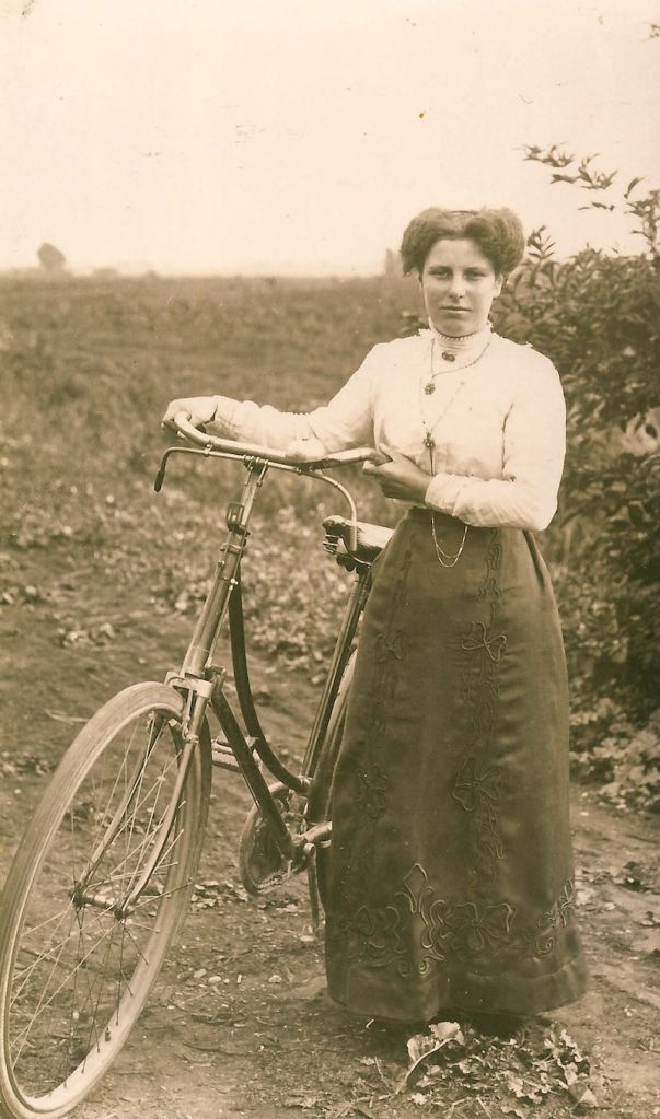 Ethel May Martin with bike circa 1908
