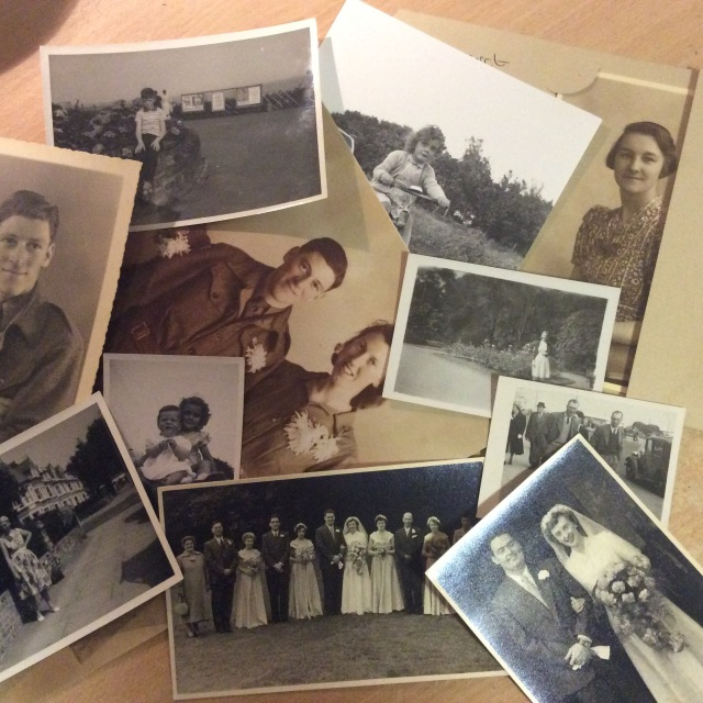 Collection of photographs on a desk