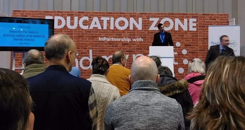 Myko Clelland (FindMyPast), presenting in the Education Zone.